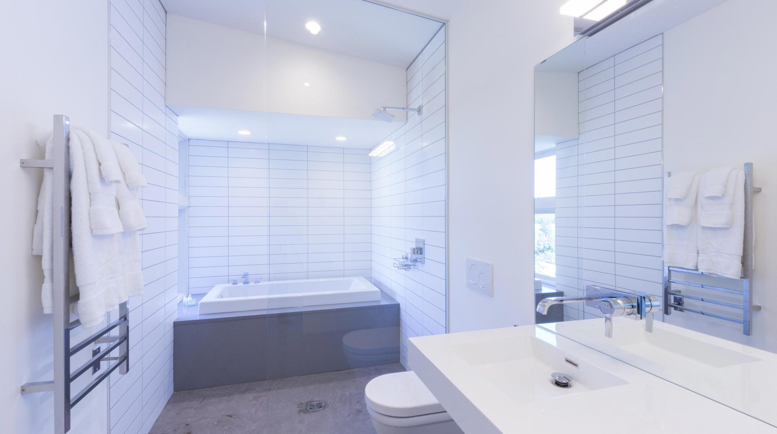 QuarterDeck Beach Lofts Modern Bath Concrete Glass