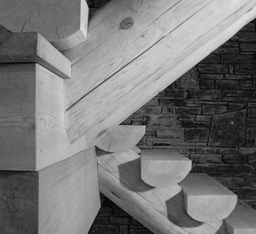 Carved Cedar Log Staircase Crafted by Lloyoll Timber-Framers